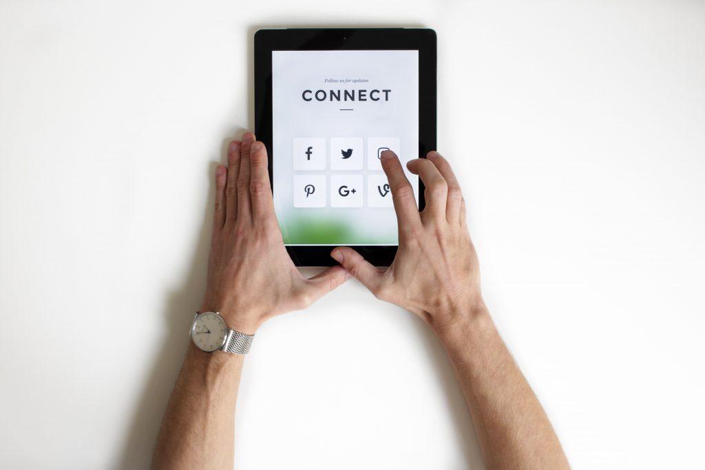 Tablet displaying social media apps.