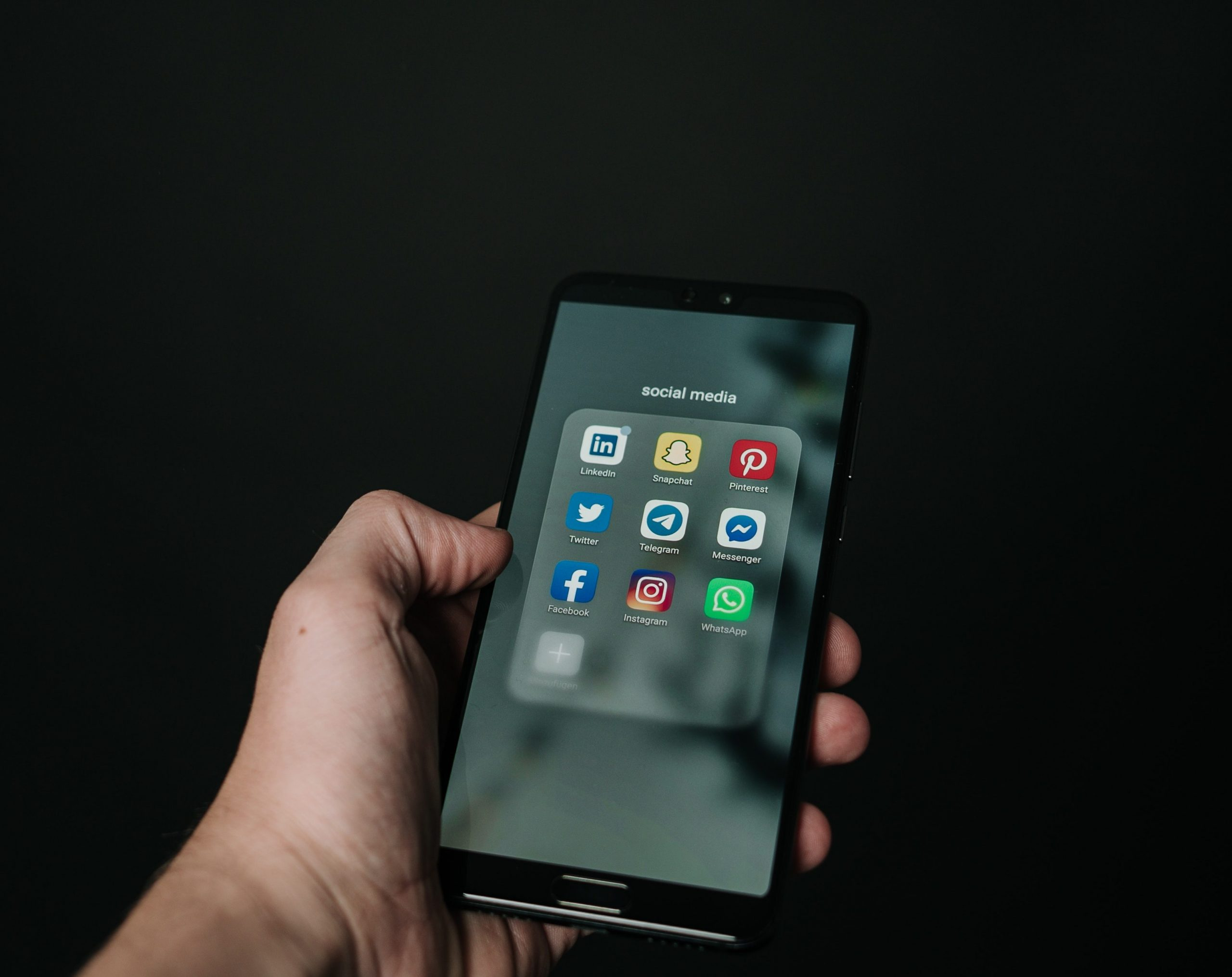 phone with social media apps on screen